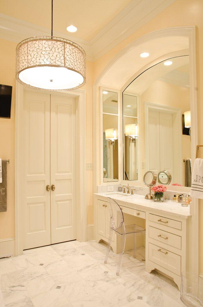 chair for vanity in bathroom. Marble bathroom with lucite vanity chair  double doors pendant light