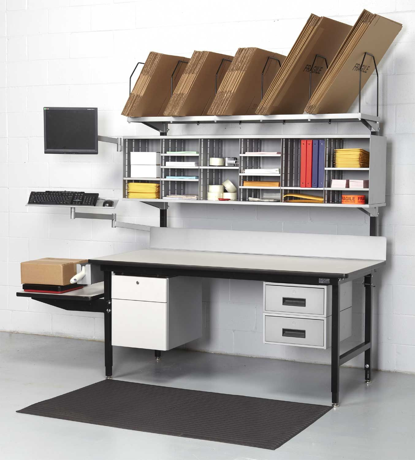 I like this packing station for the divided wall unit to store a variety of bags and boxes.