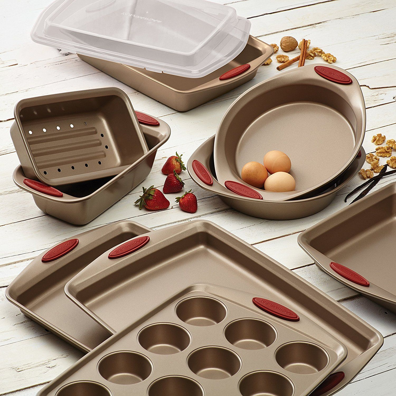 Rachael Ray 10-Piece Cucina nonstick bakeware set, Latte Brown with cranberry red handle. Featuring durable carbon steel construction with rolled-rim edges designed for easy, #everydayuse.