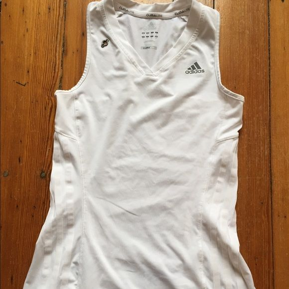 White Adidas workout tank White CumaLite Adidas tank with lower back zip pocket. Perfect for keys or cards. Shoulder keyhole cutout for headphone wire. Adidas Tops Tank Tops