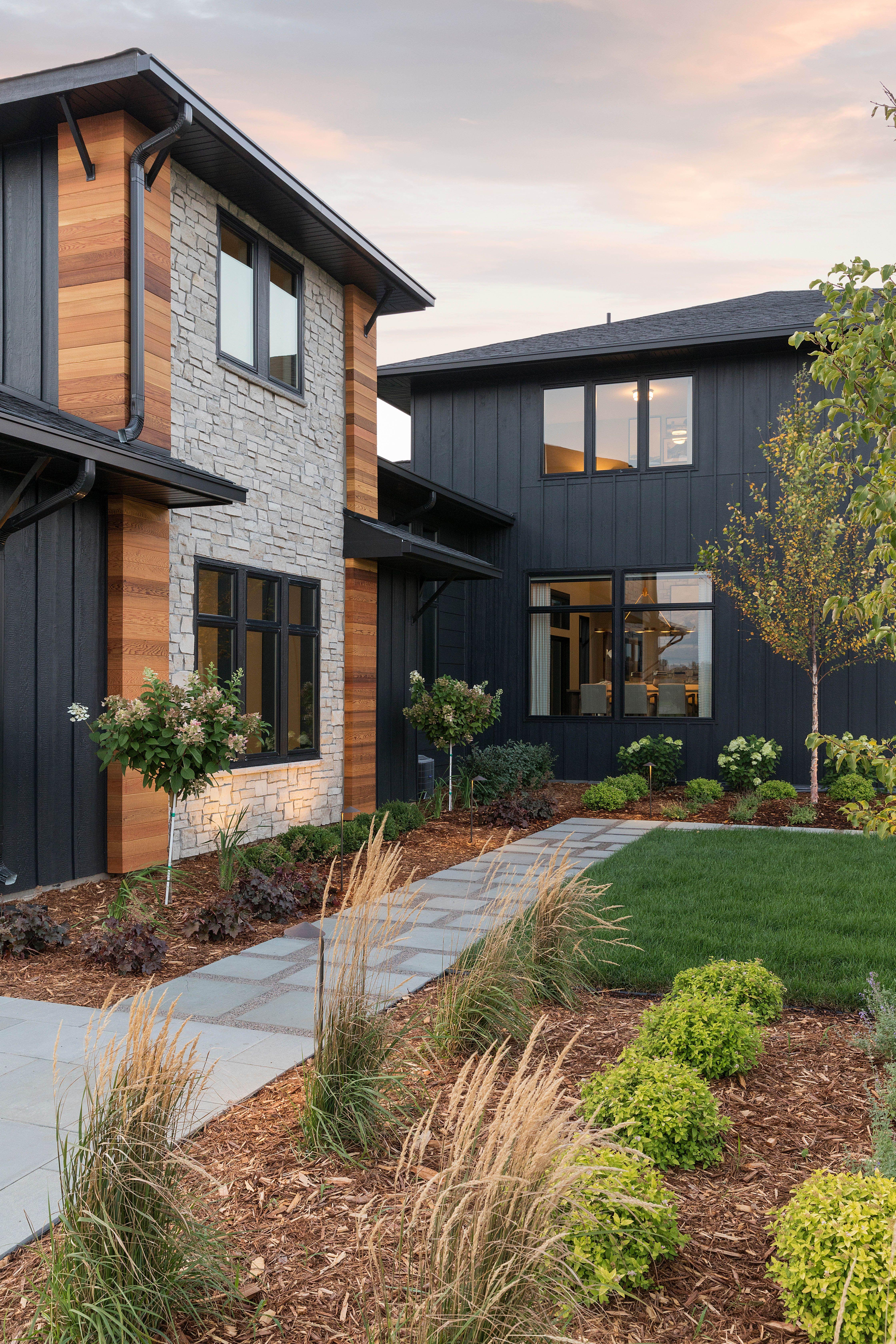 Bold Black Stone And Wood Exterior Industrial Modern Home Mountain Home Exterior House Exterior Modern Farmhouse Exterior