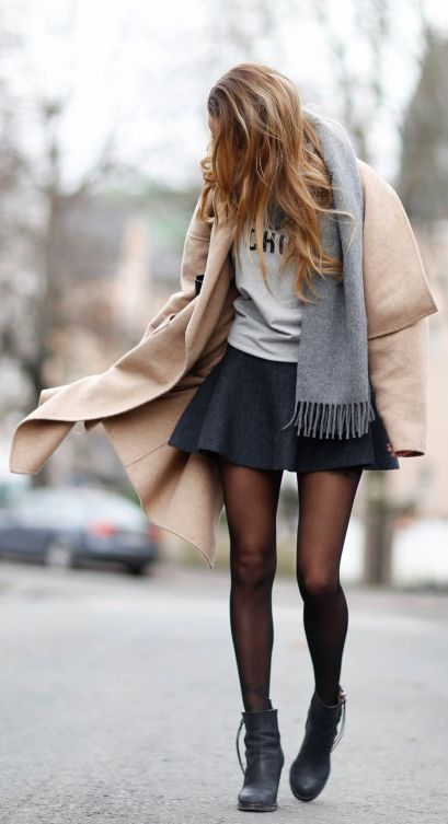 Street Style, February 2015: Julia Toivoloa is wearing a coat from Zara, a grey Acne scarf and a black mini skirt from H&M