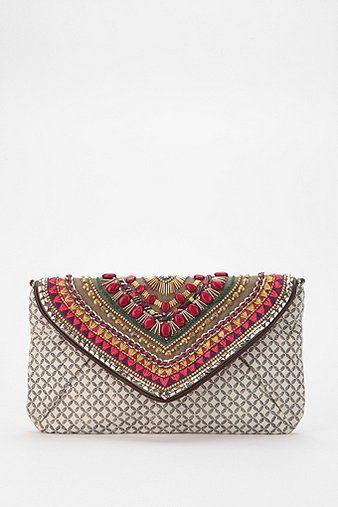 cartera de mano de estilo étnico con piedras. | carteras