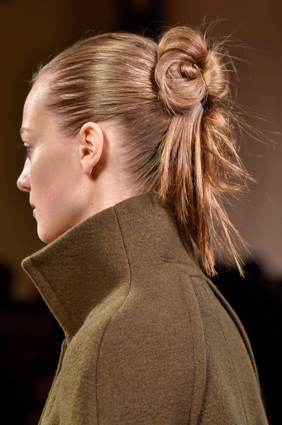Redken ambassador Guido Palau styled Victoria Beckham's models with cool duel-textured knots, sleek at the top and matte at the bottom. The makeup by Pat McGrath was all about the heavily underlined eyes. - Cosmopolitan.co.uk