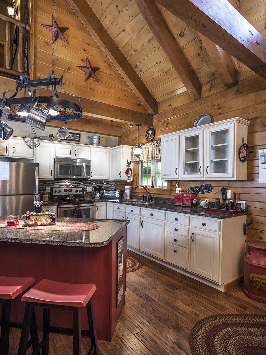 This open-concept log home kitchen by Hochstetler Log ...