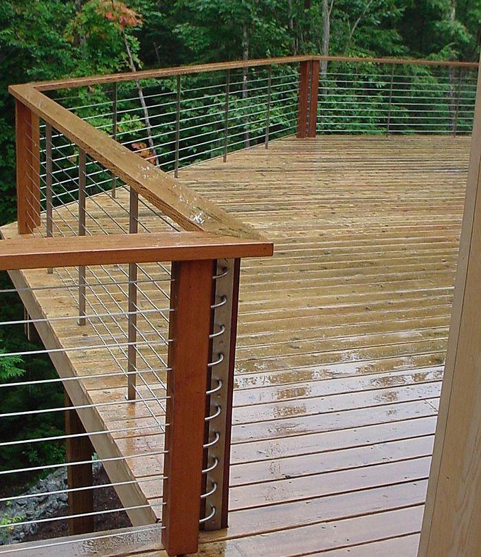 Love the horizontal metal rails, against the wood