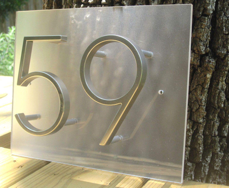 Modern house numbers on plexiglass
