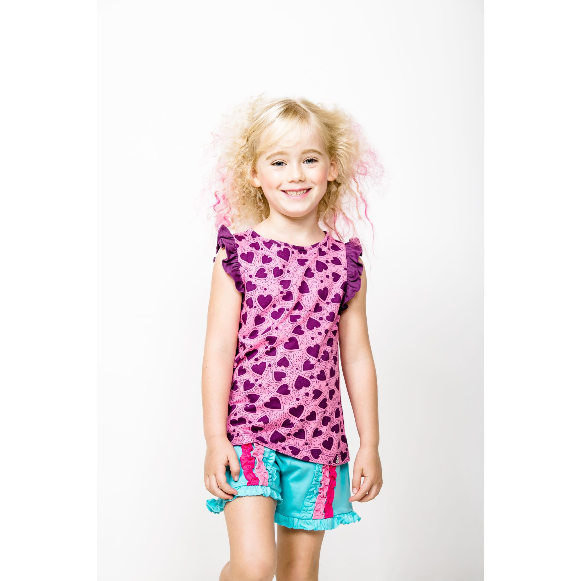 Super pinky round neck top with fancy heart print! What more can a girl ask for? This sleeveless frill top made from soft luxurious cotton jersey and is easy to match with shorts or skirt, ideal for everyday look