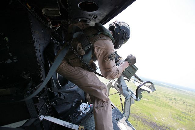 MARINE CORPS AIR STATION CHERRY POINT, N.C. (June 19, 2012) – Staff Sgt. Corey Butts a UH-1N, Huey, crew chief with Marine Light Attack Helicopter Squadron 467,  mans the .50-caliber machine gun, aboard a UH-1N Huey, in support of Exercise Mailed Fist, June 19. HMLA-467 brought two Hueys for the exercise where 467 and 2nd Light Armored Reconnaissance practiced forward air control and joint terminal attack control missions at range Golf 11.