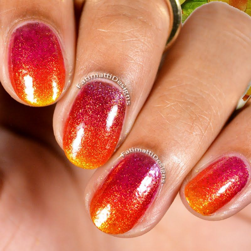 This gradient manicure in jewel-toned nail polish shades is simply ...