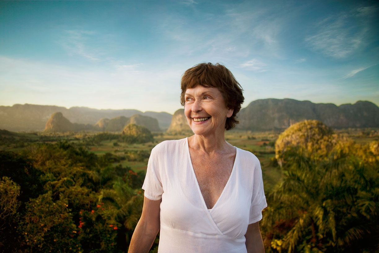 Mature woman at sunset in Vinales, Cuba on vacation, get away, holiday, grandmother for healthcare.