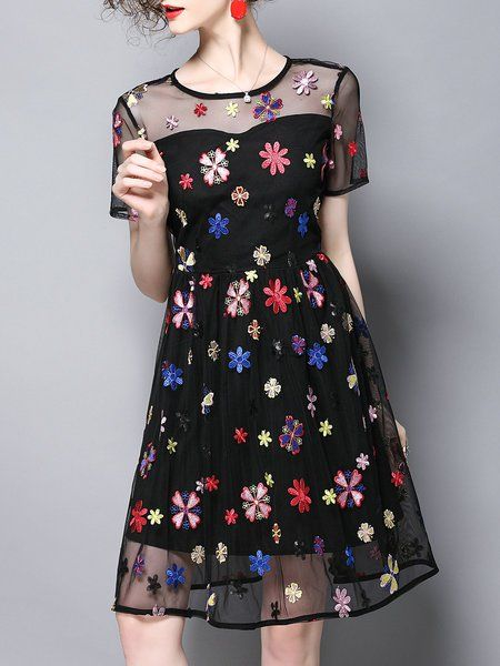 Shop Midi Dresses - Black Short Sleeve Floral A-line Paneled Midi Dress online. Discover unique designers fashion at StyleWe.com.