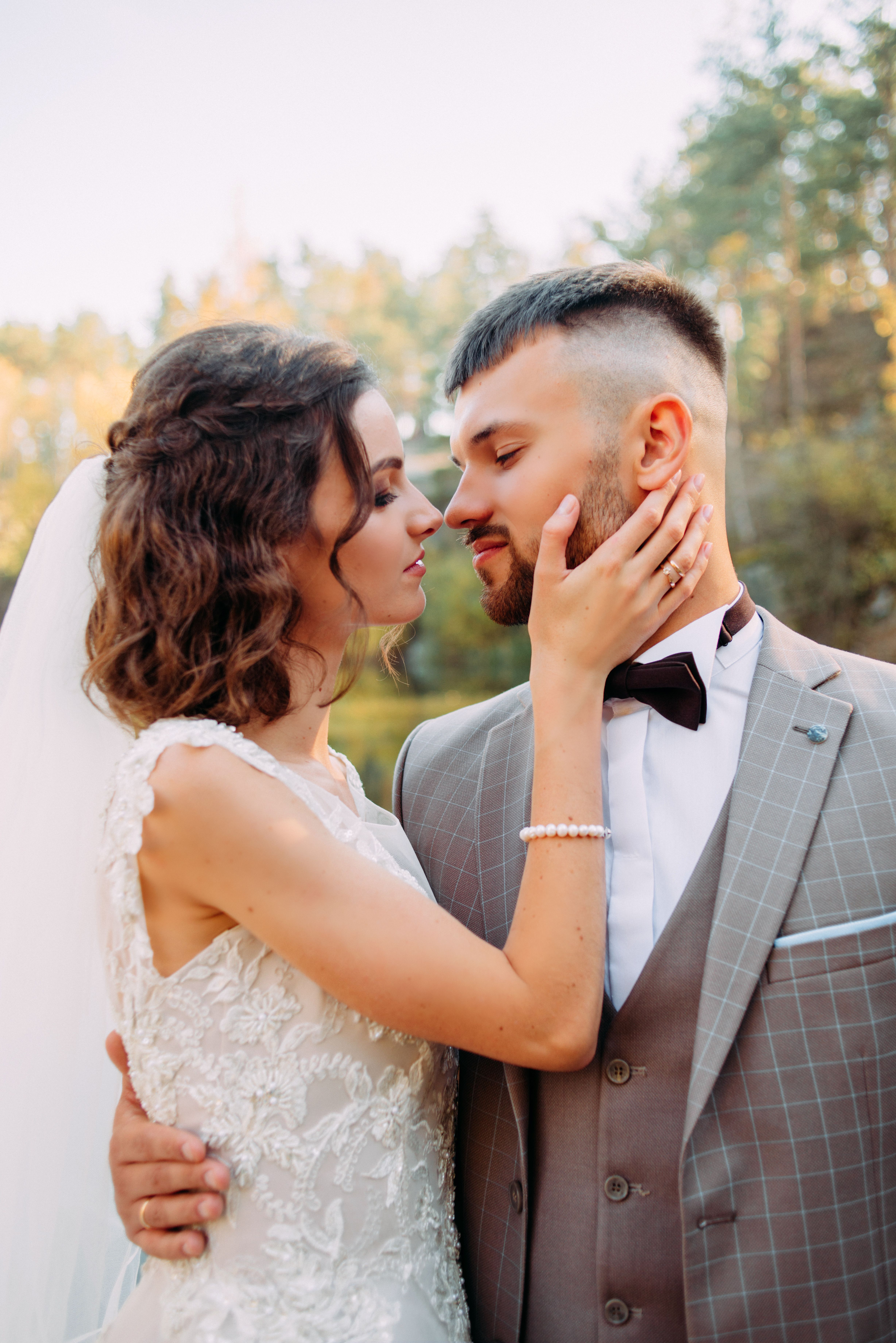 Photo of 4 Shocking Gown Snapshots Woman In Wedding Dress Holding A Man's Right Chin With…