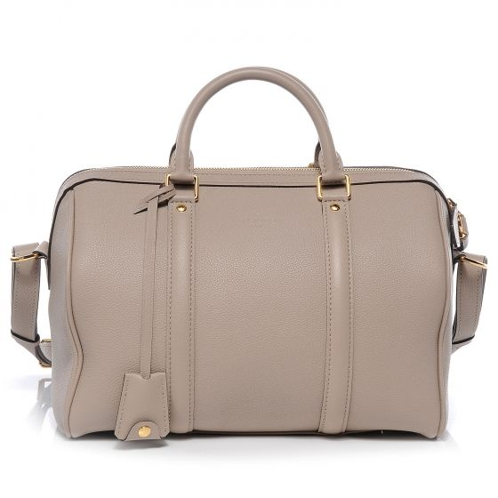 This is an authentic LOUIS VUITTON Sofia Coppola SC Bag PM in Galet. This ultra chic understated tote is crafted of rich calfskin leather in a neutral stone color.