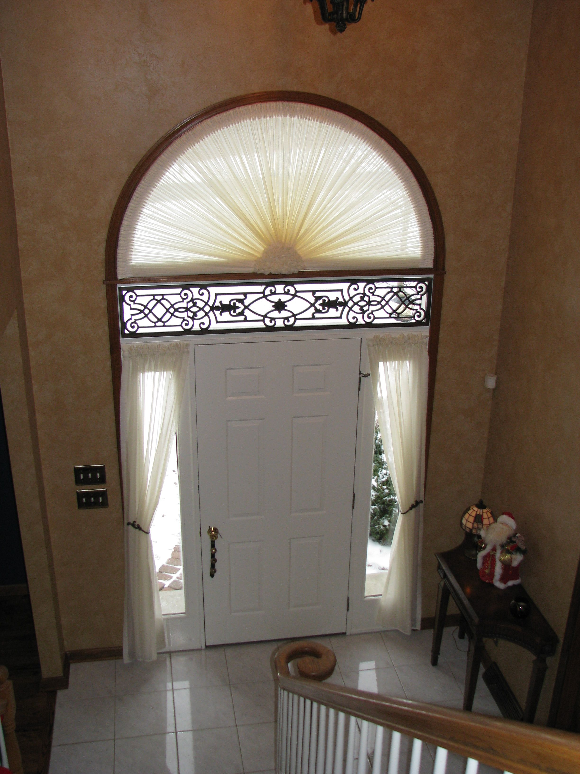 Foyer Window Shutters : Foyer treatment in sheer sunburst arch with