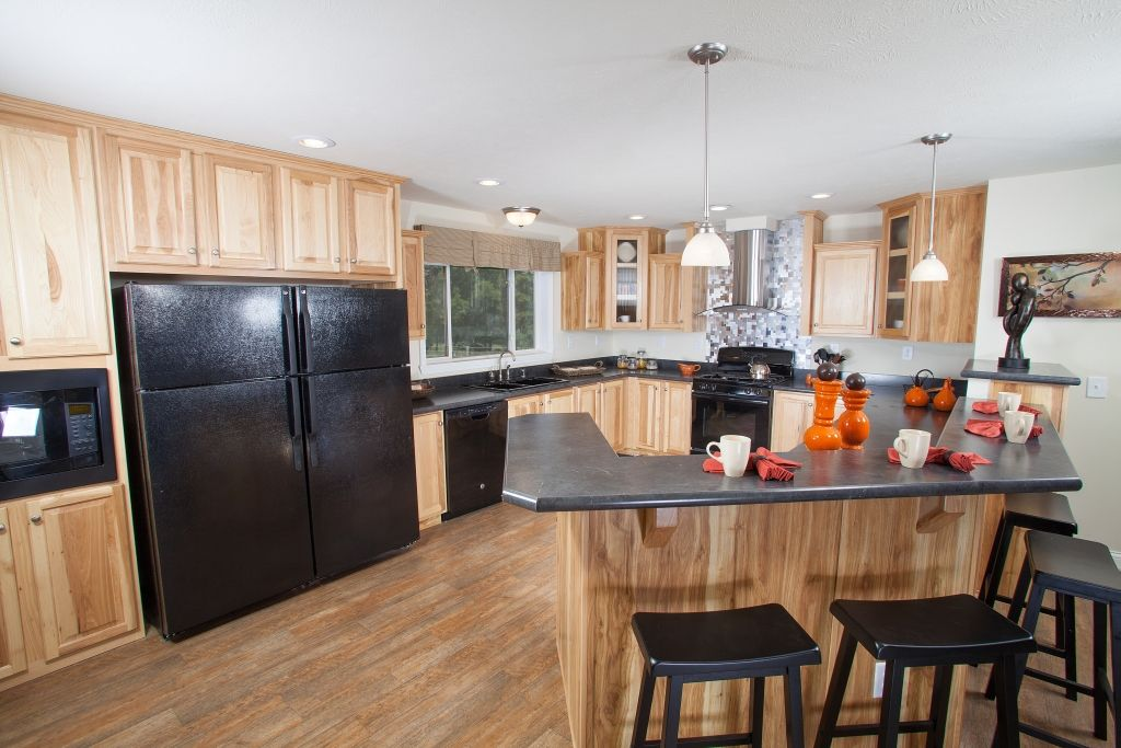 The Kitchen In The Sabre RX848A   Grandville LE Modular Ranch Home   A  Great Hickory Cabinet Kitchen   Featuring This Great Stainless Steel Range  Hu2026