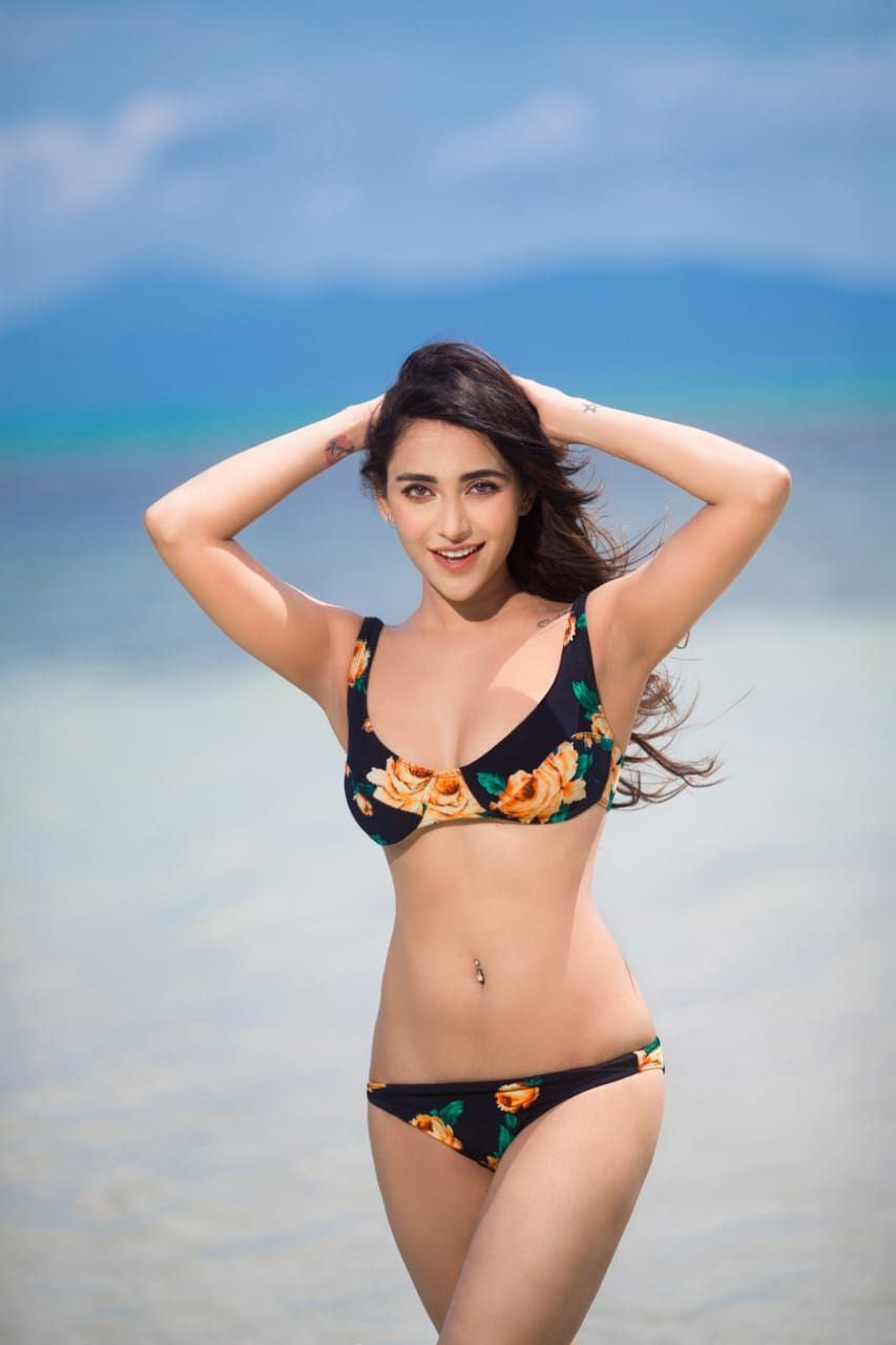 Bollywood actress Angela Krislinzki sexy bikini looks during her