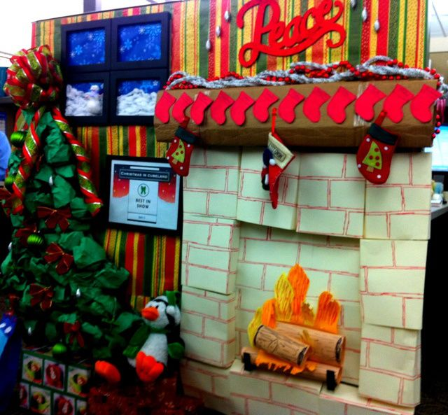 Fake fireplace for cubicle contest work ideas for Cubicle theme ideas