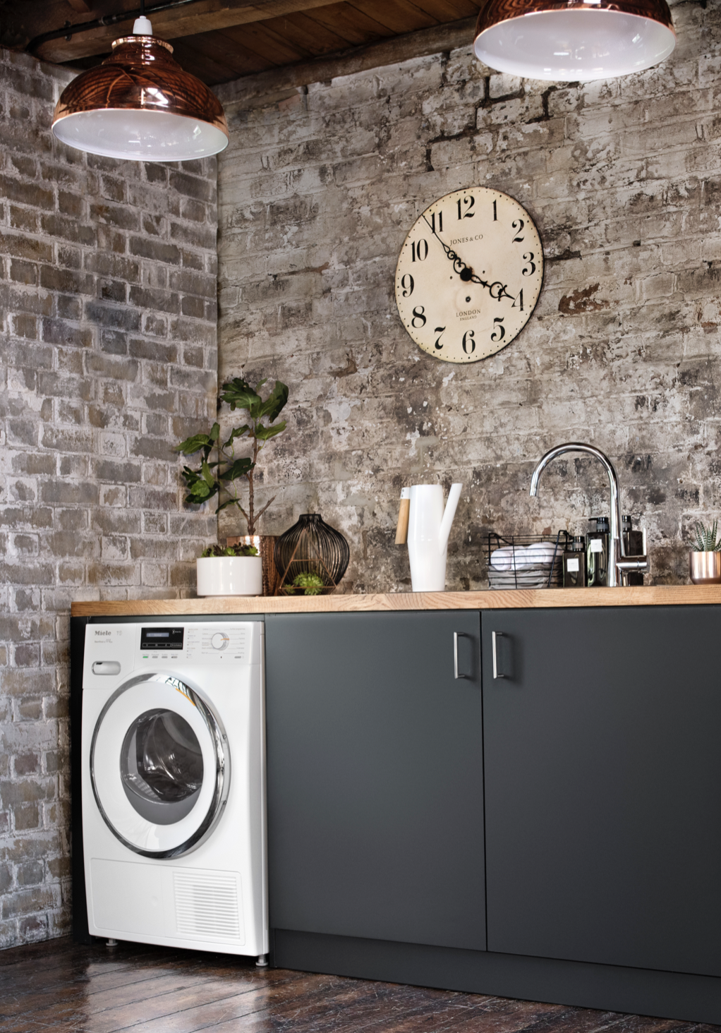 Create An Industrial Style Utility Room By Pairing Dark Surfaces