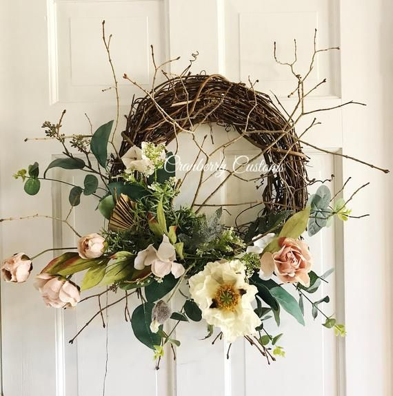 Photo of Modern wreath. Realistic wreath. Lifelike wreath. Wreath for spring. Modern spring wreath. Contempor