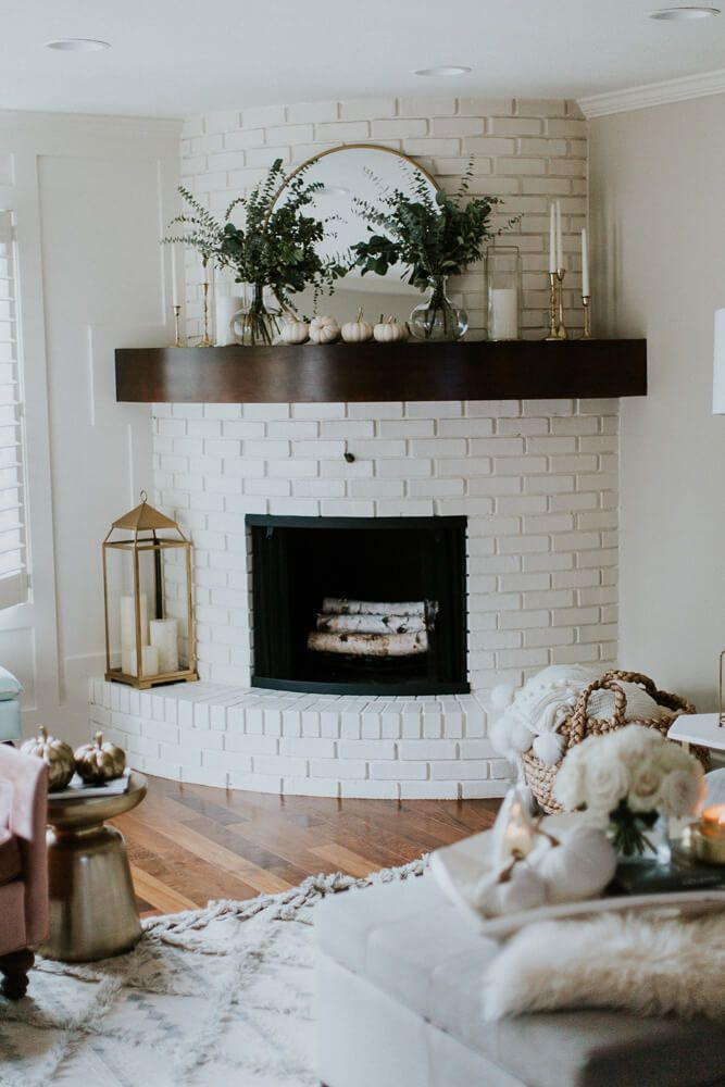 A Curved Fireplace Decorate In Brass And Nature Farm
