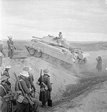 A British Crusader III tank crosses a ditch at Mersa Matruh, Libya during the British 8th Army's pursuit of the retreating Axis forces, November 1942