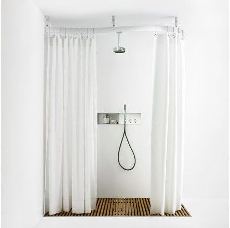 Agape Design shower curtain rail Cooper shown in corner installation. Agape Design shower curtain rail Cooper shown in corner