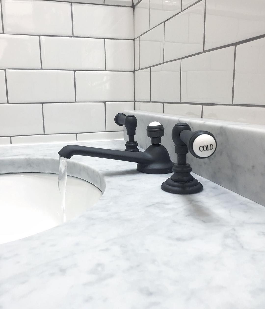 Carerra Marble White Subway Tile Oil Rubbed Bronze Faucets
