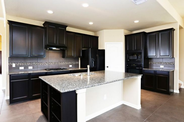 Espresso Kitchen Cabinets With Black Appliances And White Trim