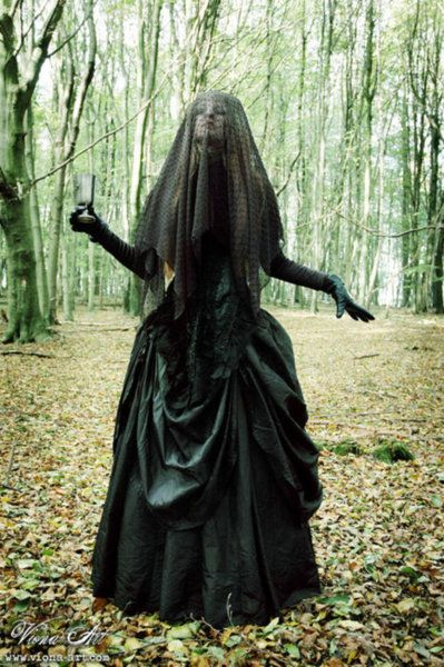 Woman in black.  I might go with this. Spooky black veil Halloween Costume