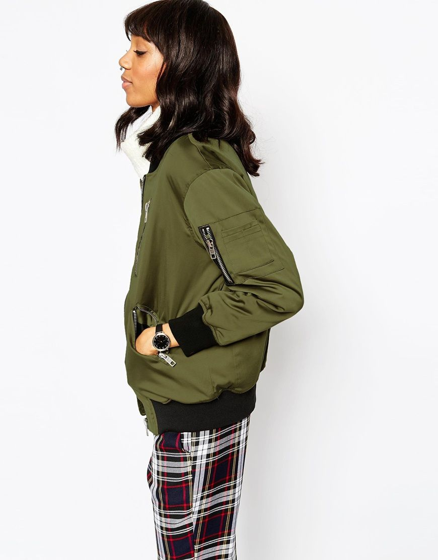 Love this olive green bomber jacket with exposed zippers