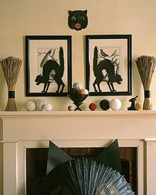 Amazing idea!  Make Halloween cutouts to place in front of your otherwise normal framed artwork to spice up the holiday decor!  Fantastic!