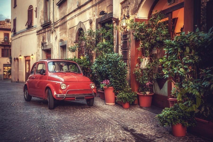 Old vintage cult car parked on Italian street by JaroslawPawlak