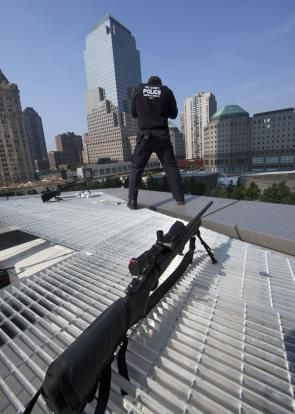 In this Sept. 11, 2013 file photo, a police officer provides security at the National September 11 Memorial at the World Trade Center during ceremonies marking the anniversary of the terrorist attacks in New York.