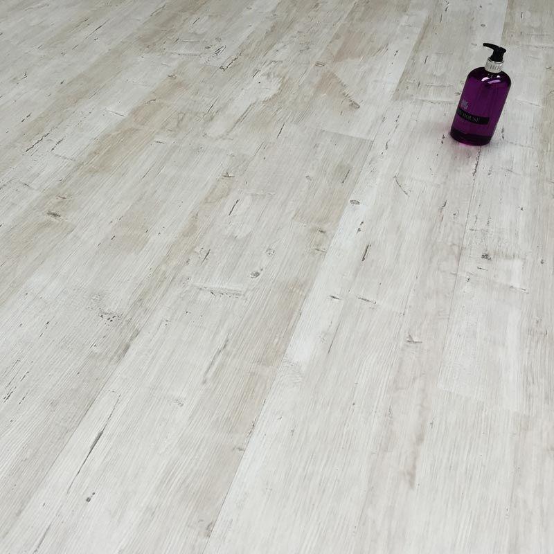 The engrave white pine luxury vinyl plank flooring is a for Luxury vinyl bathroom flooring
