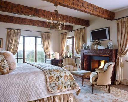 Wood Beams On The Ceiling Lend Old World Appeal To This Cozy Master Bedroom