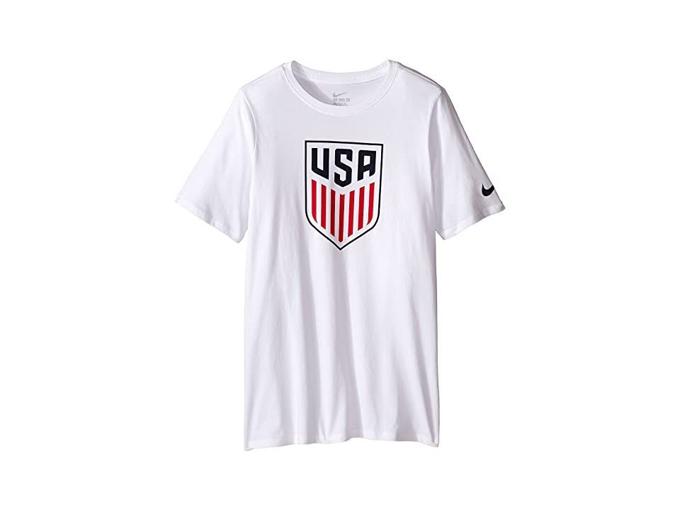 Nike Kids USA Crest Tee (Little Kids/Big Kids) (White/White) Boy's T Shirt. He can rep the national soccer team with pride in the patriotic USA Crest Tee. Regular fit is relaxed  but not sloppy  and perfect for workouts or everyday activities. Classic  lightweight  and comfortable cotton. Rib crew neck with interior taping. Short sleeves with Swoosh at left. USA Crest boldly displayed at chest. Straight hemline. 100% cotton. M #NikeKids #Apparel #Top #TShirt #White
