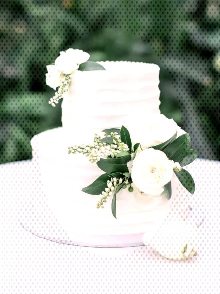 Three Tier White Line Texture Wedding Cake »