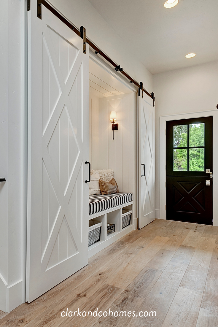 The Heartland Double Barn Doors Slide Apart To Reveal A Built In Bench With Cubbies Below For In 2020 Home Barn Doors Sliding Double Barn Doors