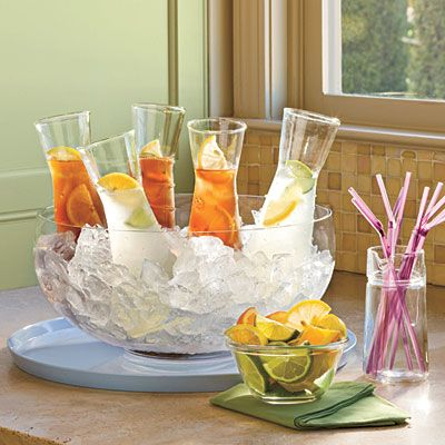 fill small carafes with iced tea, water, lemonade, juice, wine... and nestle in a large serving bowl filled with ice