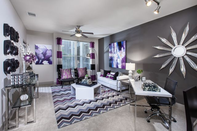 Slate Grey Accent Wall With Colorful Patterns To Liven Up The Living Room At Enso Apartments