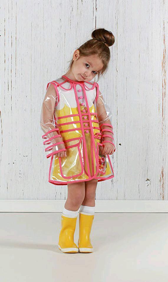 31390bd2fdf0 Stylish Transparent Girls  PVC Coat. Pink Trim. Clear Waterproof ...