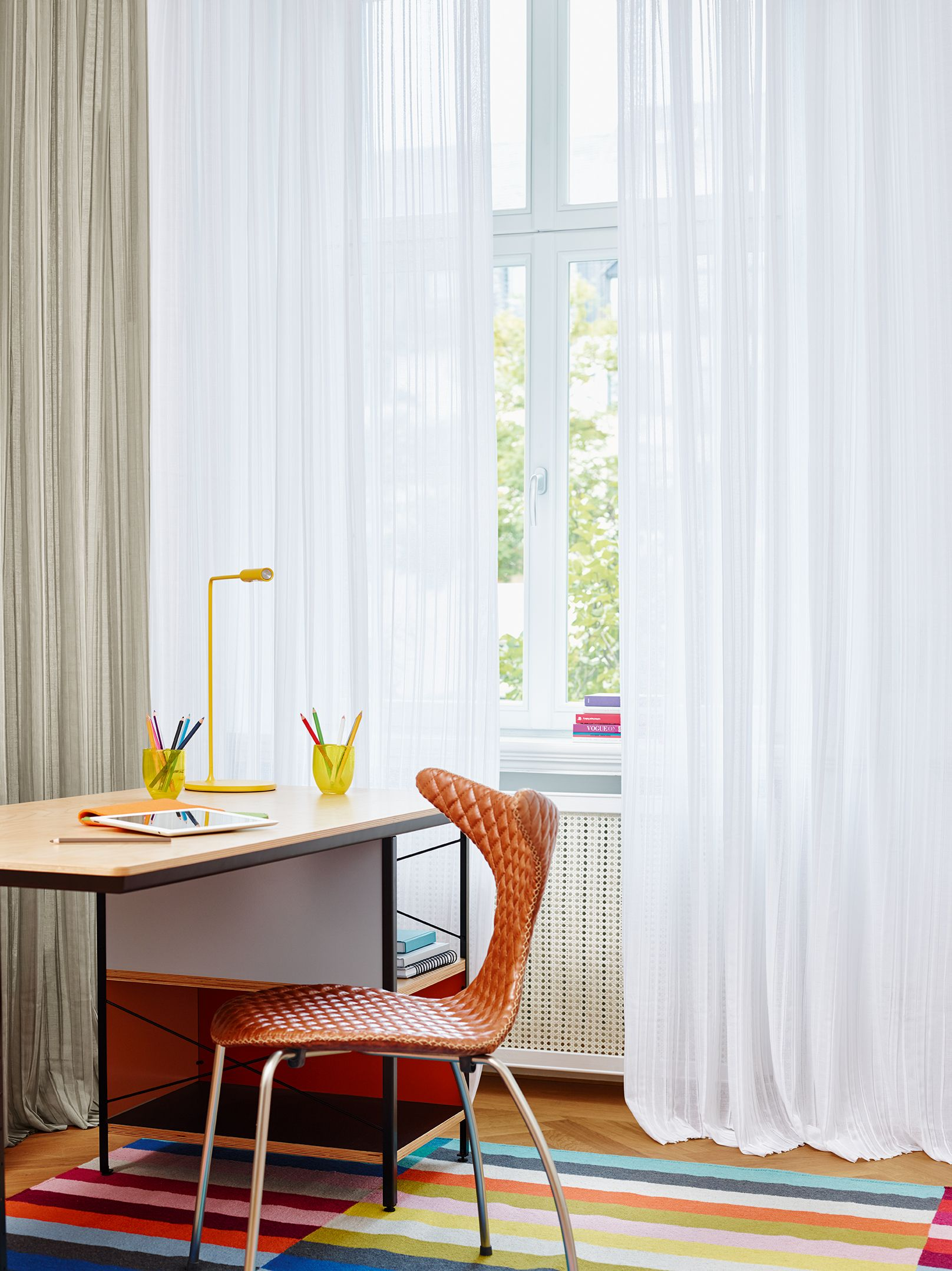 Workplace Near The Window With Soft Curtains And Colourful Carpet