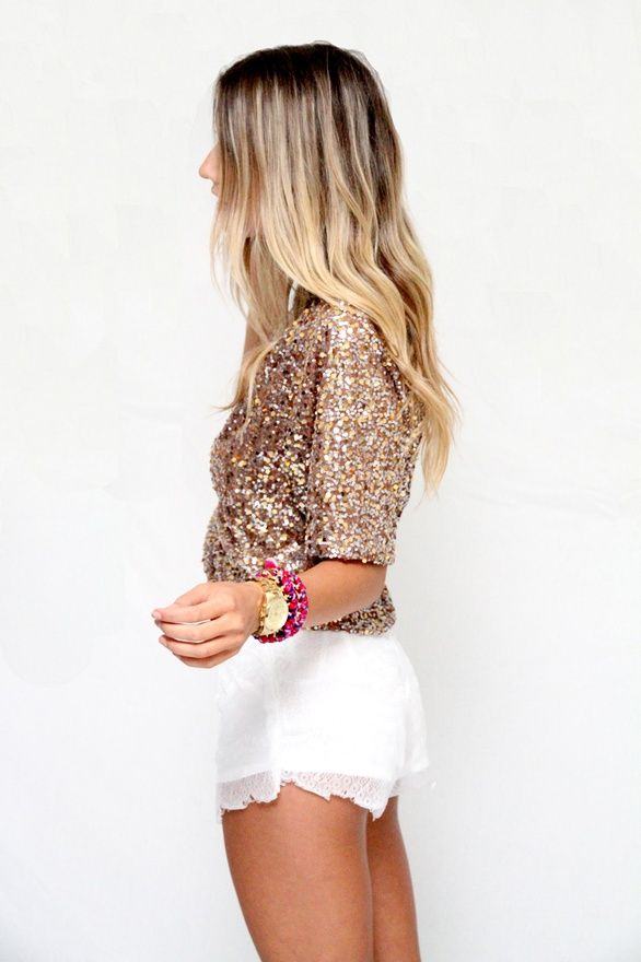 gold sequins, raw-edge white shorts, an armful of bangles, and beachy blonde waves