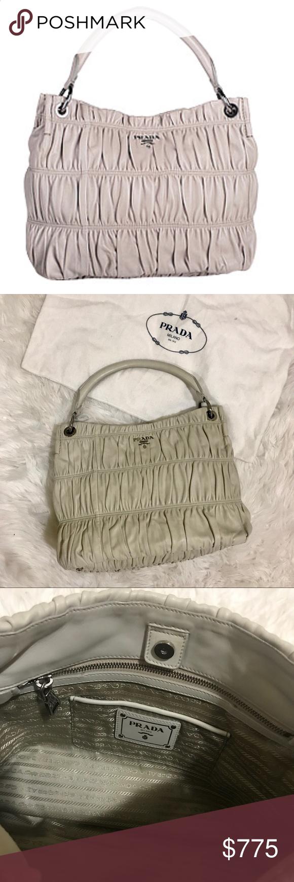 10c99fff02bc Prada Nappa Gaufre Hobo Bag Beige lambskin leather with embossed Gaufre  effect, single shoulder strap, silvertone hardware, open top closure, 4  metal feet.