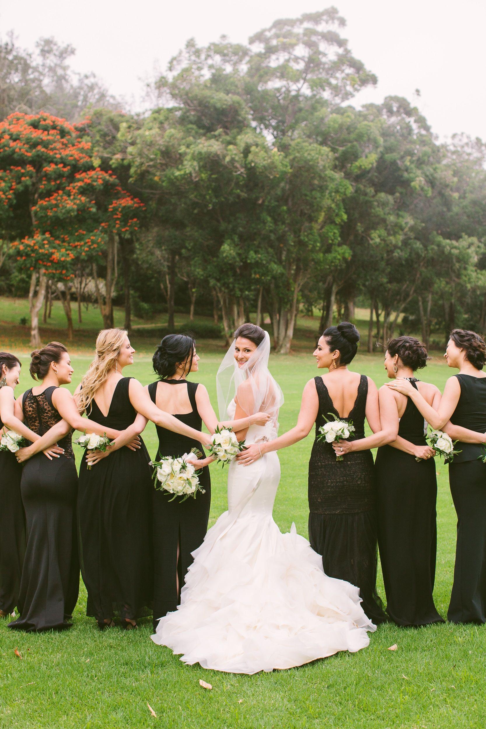Long, mismatched black bridesmaid dresses