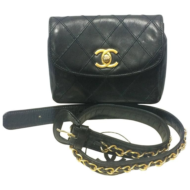 ed7812c55b2b Vintage CHANEL black leather waist bag, fanny pack with golden chain belt. 1