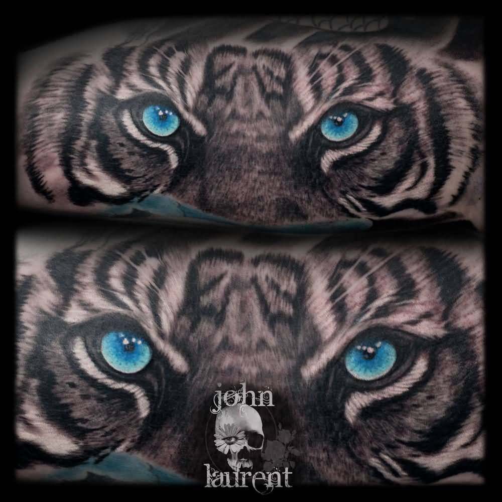 Blue tiger eyes tattoo idea by john laurent tattoos pinterest blue tiger eyes tattoo idea by john laurent izmirmasajfo
