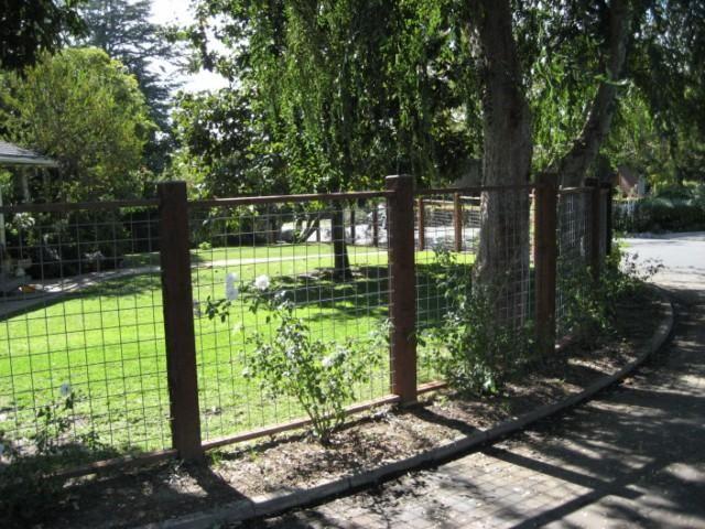 Western Fence Company square grid fencing, wood frame \ steel grid