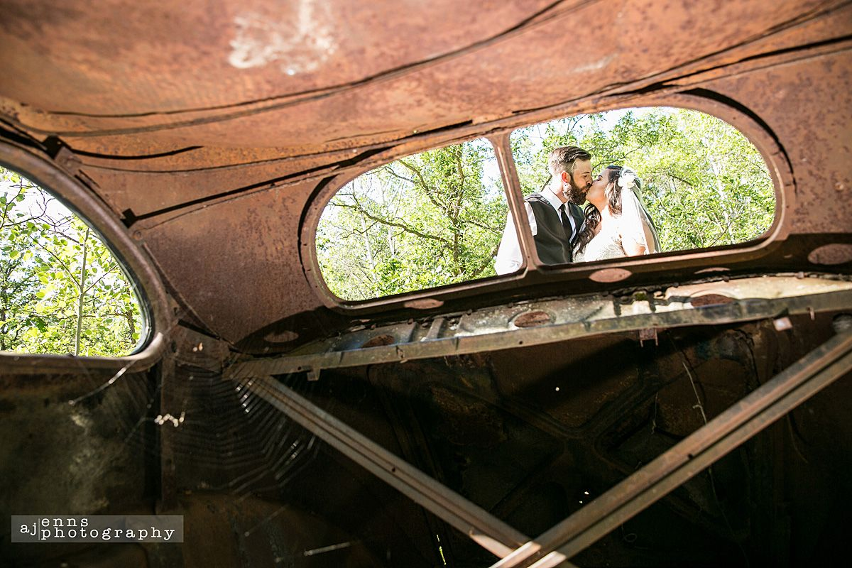 Wedding car decorations just married  Kissing from viewed from within an abandoned car  Newlywed Images